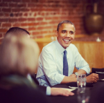 president barack obama sitting at a table from instagram